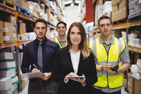 Portrait of warehouse manager and workers in warehouse