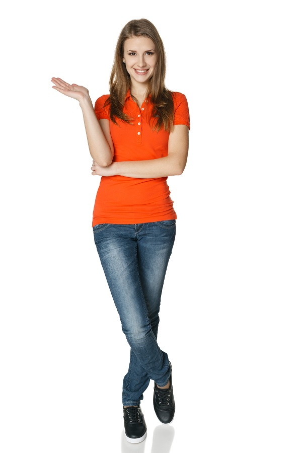 Woman holding blank copy space on her open palm standing in full length, isolated on white background