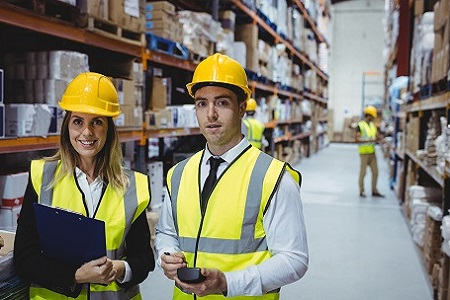 Portrait of warehouse managers looking at the camera